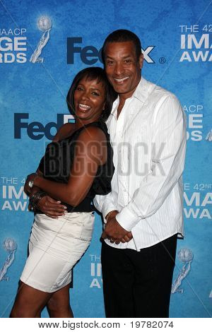LOS ANGELES - FEB 12:  Vanessa Bell Calloway, Phil Morris arrives at the 2011 NAACP Image Awards Nominee Reception at Beverly Hills Hotel on February 12, 2011 in Beverly Hills, CA