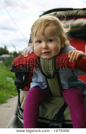 Funny Babygirl In Pram
