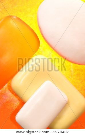 Pieces Of Soap On A Yellow Background