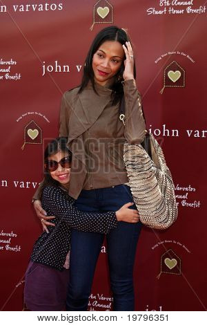 LOS ANGELES - MAR 13:  Zoe Saldana, niece Kayla arriving at the John Varvatos 8th Annual Stuart House Benefit at John Varvaots Store on March 13, 2011 in Los Angeles, CA