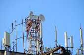Telecommunication Base Stations Network Repeaters On The Roof Of The Building. The Cellular Communic poster