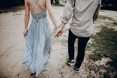 Stylish Hipster Couple Walking, Holding Hands. Man And Woman Embracing, In Love Relaxing In Summer P poster