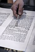foto of tora  - Torah reading in a synagogue with a hand holding a silver pointer - JPG
