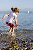 stock photo of children beach  - little cute girl playing at the beach.