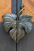 stock photo of door-handle  - door handle made as a grape leaf - JPG