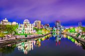 Hiroshima, Japan skyline and Peace Memorial Park at night. poster