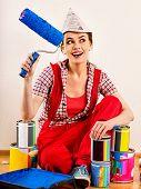 Repair home woman holding paint roller for wallpaper. Aggressive screaming girl in newspaper cap ren poster