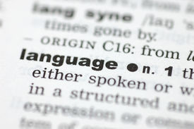 stock photo of pronunciation  - A close up of the word language from a dictionary - JPG