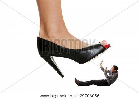 Woman shoe stepping on business men. Concept photo on white background