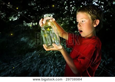 Boy with a jar of fireflies