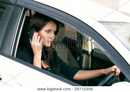 woman in car calling by phone