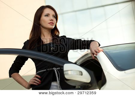 woman standing near car