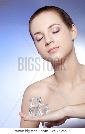 woman with closed eyes holding ice