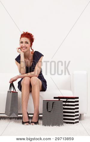 Beautiful Redhead With Shopping Bags