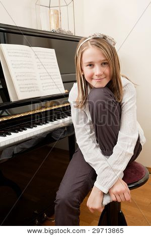 Young Girl And Her Piano