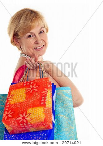 Pretty mature lady carrying shopping bags
