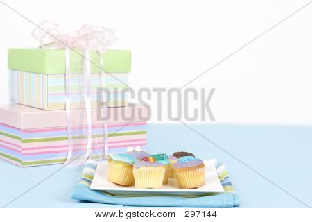 Little Cakes Sitting On A White Plate