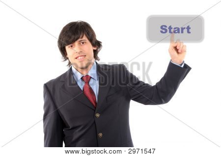 Young Business Man Presses The Start Button