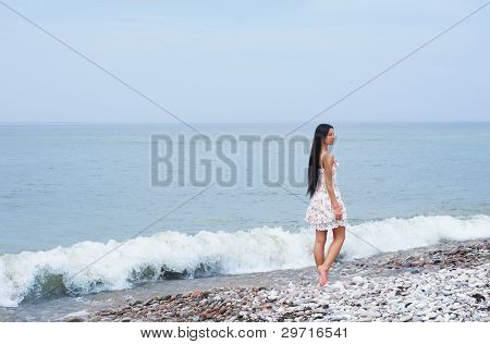 Young beautiful woman near the sea