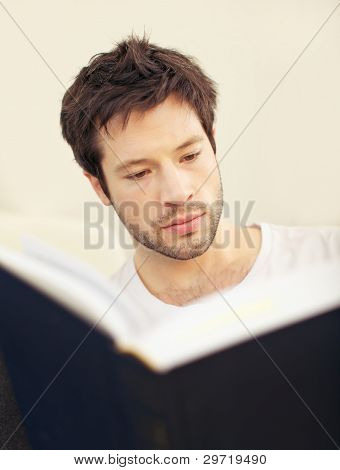 Serious Scholar With Large Teaxtbook