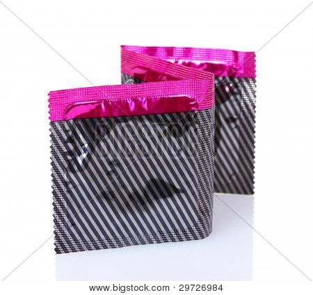 Three condoms in pack isolated on white