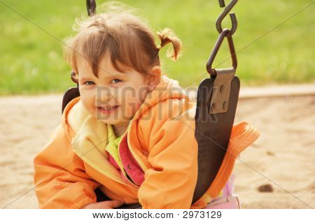 Smiling Little Girl At The Park