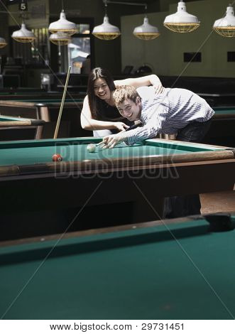 Couple playing pool
