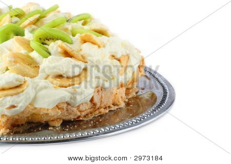 Part Of Pavlova Cake With Banana And Kiwi Over Metal Dish
