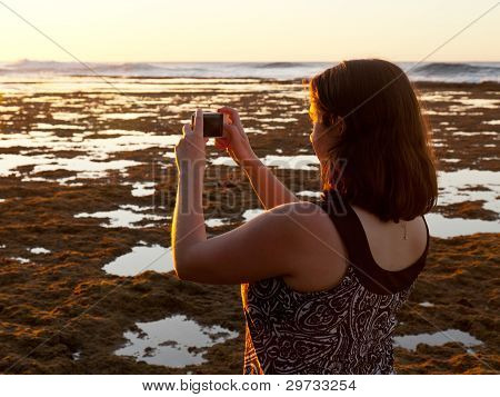 Girl Taking Photo Of Sunset On Phone
