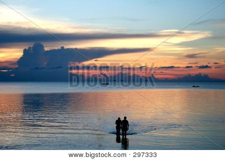 Couple On The Beach Sunset