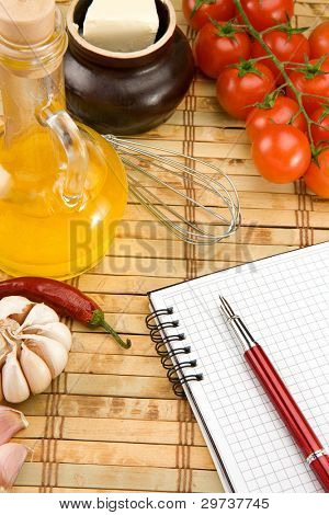 recipe notebook cookbook with food ingredient and spices on wood background