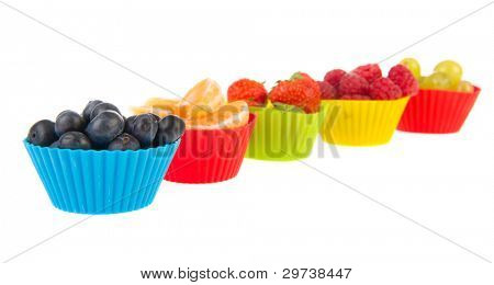 Fresh assortment soft fruit in little cups isolated over white background
