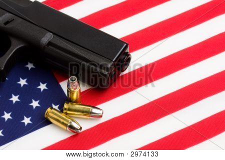 Gun Over American Flag