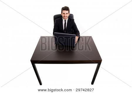 Top view of a young business man working on computer at office desk