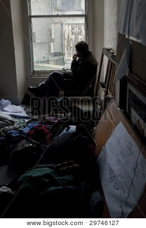 Occupy Exeter Activist Sits In The Guard Room Of Occupy Exeter Site 2 And Looks Out Over Exeter Cath