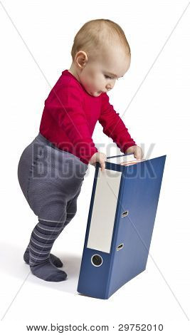 Small Child Standing Next To Blue Ring Binder