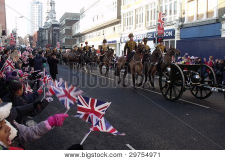 LONDON- FEB 7: Crowds of unidentified people welcome the kings troop royal horse artillery to the town of woolwich, where there new barracks are in the new royal borough of greenwich. London, feb 7, 2012