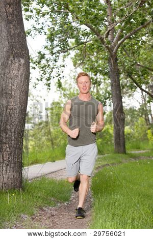 Portrait of a young man running in a park