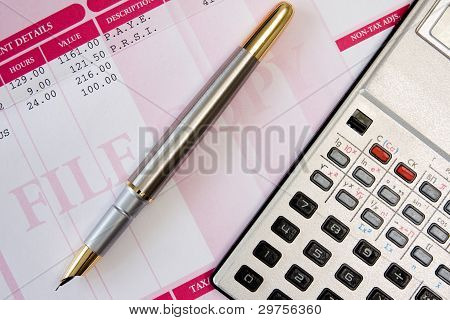 Ink Pen,calculator And Payslip