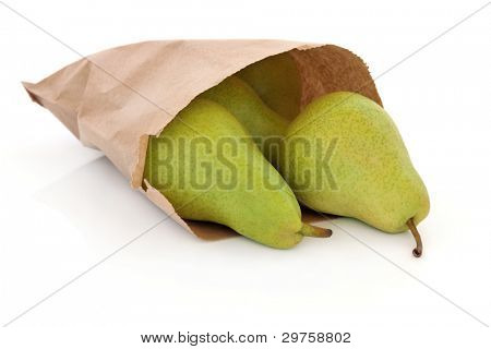 Pears in a brown paper bag isolated over white background. South African variety.