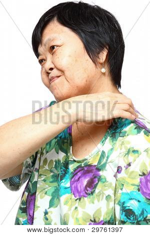 senior woman holding her aching back , massage herself