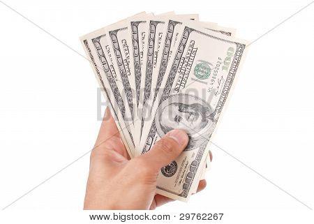 Mão com cem notas de dólar