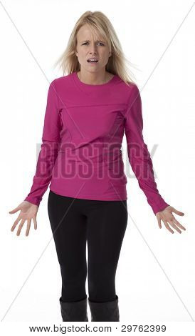 Attractive mid-thirties blond woman standing, with confused facial expression, on white background.
