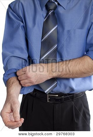 Business Man Rolling Up His Sleeves