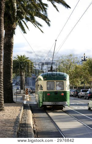 Streetcar In San Francisco With The Twin Peaks In Fog