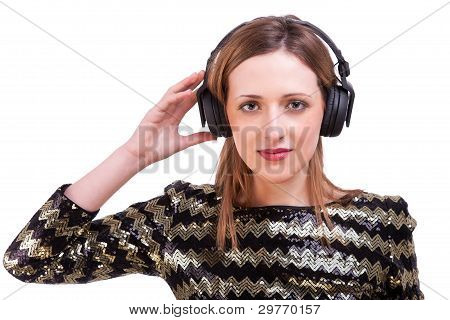 Beautiful Woman Standing Listening To Music On Black Headphones, Isolated On White, Studio Shot