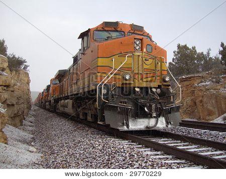 Freight train during a snowfall