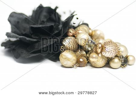 Jewelry and black rose buttonhole