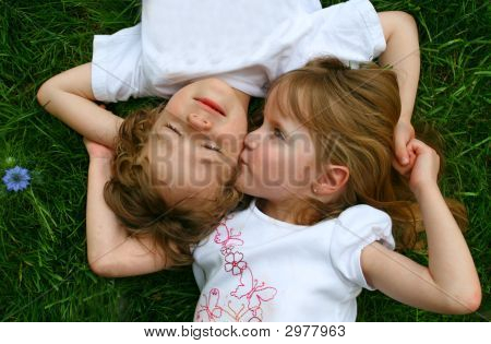 Two Children In The Grass