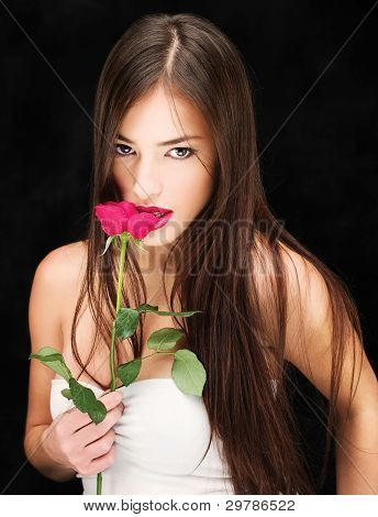 Woman With Wet Red Rose